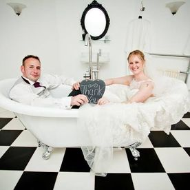 married couple in bath at hawkesyard estate