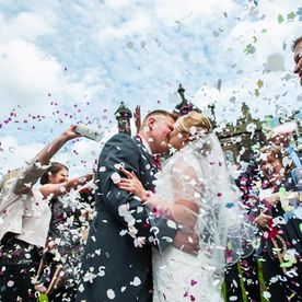 Confetti being thrown at wedding venue at Hawkesyard Estate